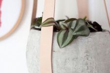 25 concrete pot on leather holders looks very modern
