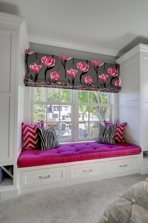 window sill nook with fuchsia upholstery in a girl's bedroom