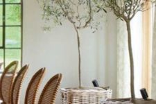 26 add a rustic touch to your dining space with trees in baskets