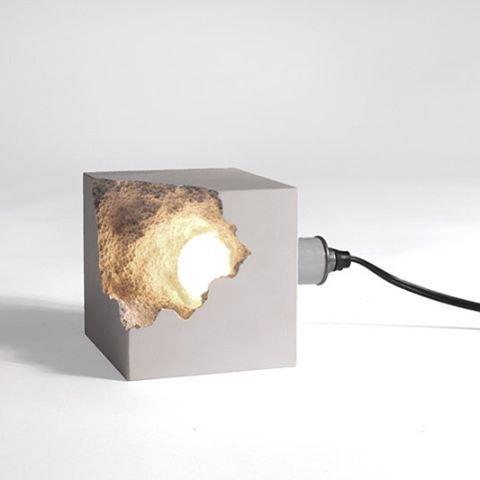 broken concrete cube with light inside is a chic modern idea