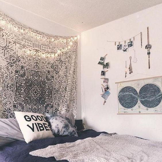 your jewelry displayed, a silver boho blanket and photos can make the bedroom boho-chic