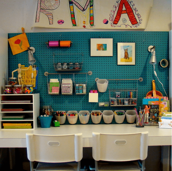 crafting and drawing station with a blue pegboard for comfy storage