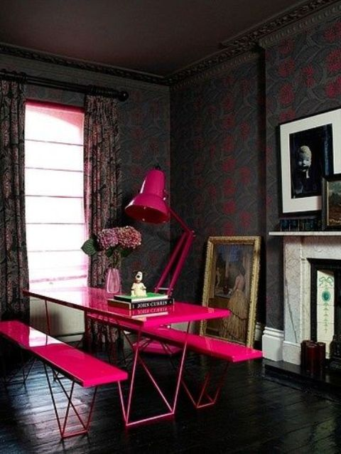 fuchsia dining set with benches and a table in a dark room
