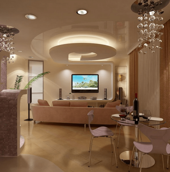 sleek ceiling with various levels of light and different chandeleirs