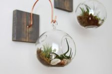 27 wood pieces with copper hangers, glass spheres with air plants