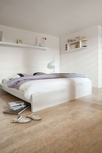 cork floors are eco-friendly and look cool and warm, that's what you need for a bedroom