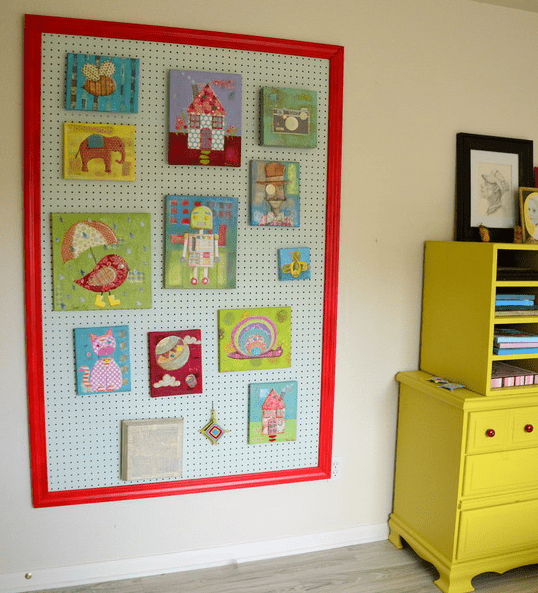 framed pegboard for displaying kids' drawings