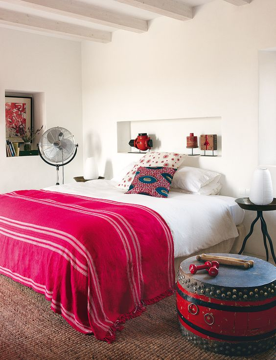 fuchsia blanket is a great idea for a boho-inspired bedroom