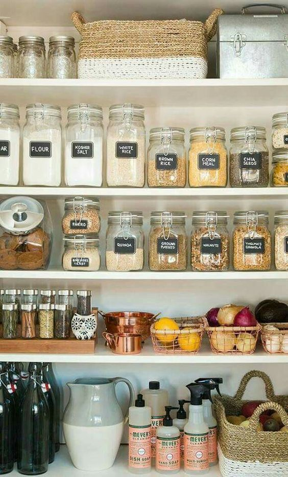 labeled organized pantry with glass jars and baskets of various kinds
