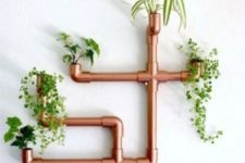 29 a steampunk or industrial interior will look great with a copper piping planter