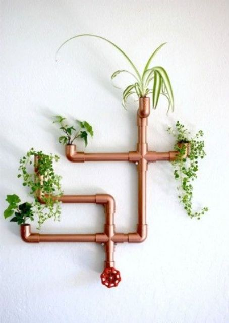 a steampunk or industrial interior will look great with a copper piping planter