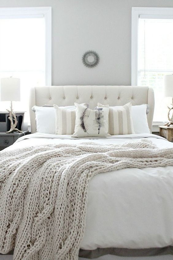 neutral bedding and an ivory knit blanket for a wintery bedroom
