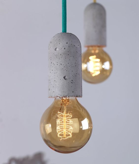 concrete socket lights with colored bulbs for industrial spaces
