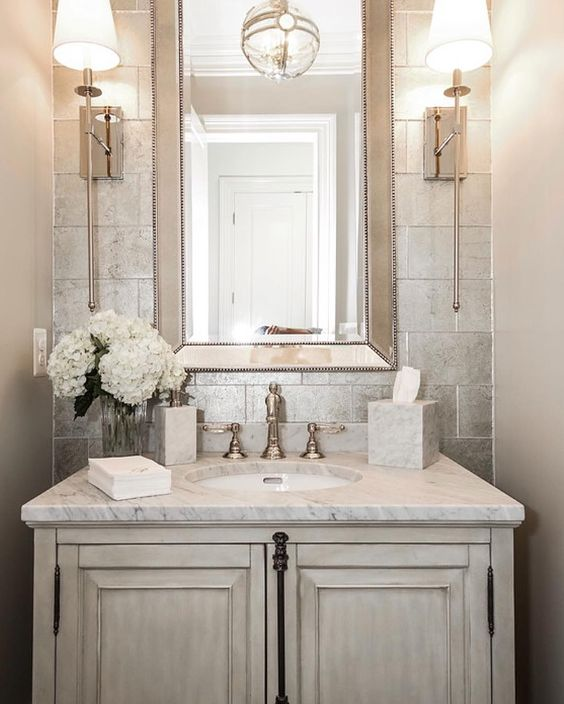 elegant powder room with a whitewashed wooden sink stand