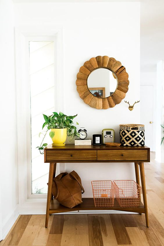 mid-century modern console table with drawers and an additional shelf