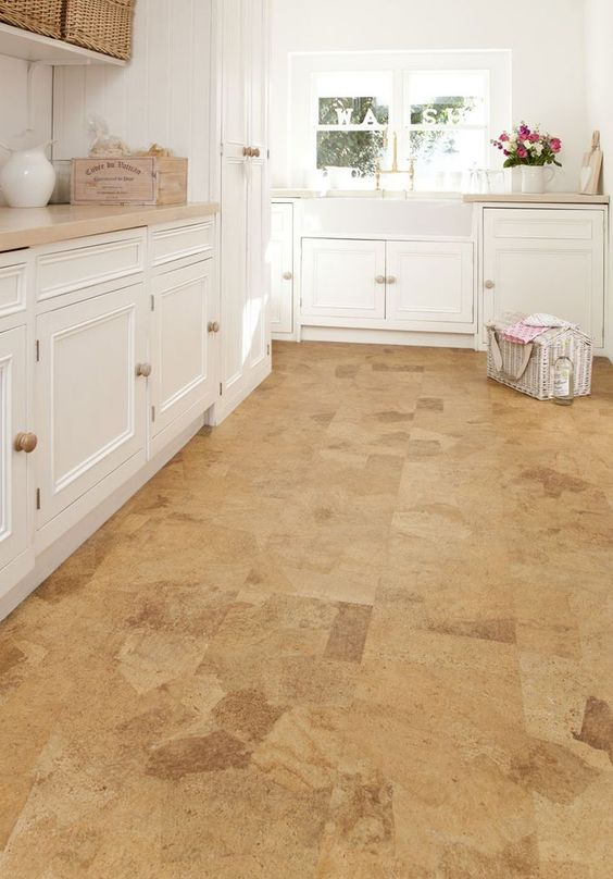 cork floors give this kitchen somewhat a warm rustic touch