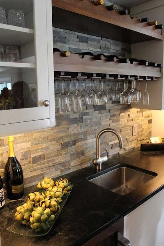 faux stone kitchen backsplash adds texture to the decor