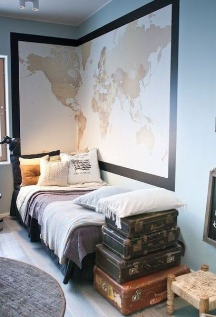 travel-inspired dorm room with a large map and old suitcases for storage