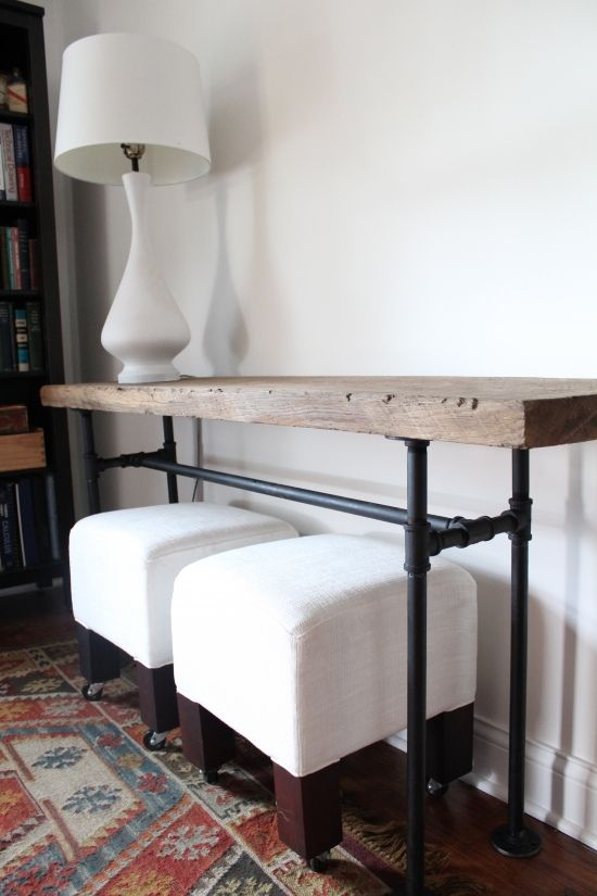 black pipe console table with a wooden top