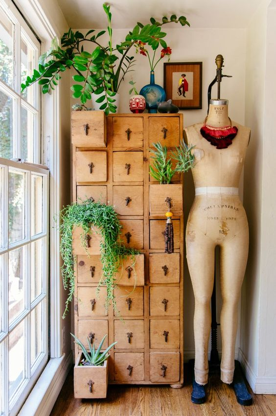 you can use a vintage dresser or apothecary piece for planting what you want