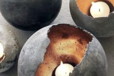 33 concrete spheres with metallics inside as candle holders