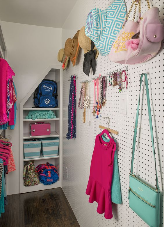 pegboard wall in a closet for all caps, bags and jewelry
