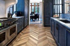 35 herringbone cork flooring is a funky touch in this dark kitchen