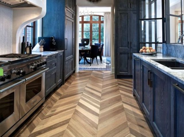 herringbone cork flooring is a funky touch in this dark kitchen