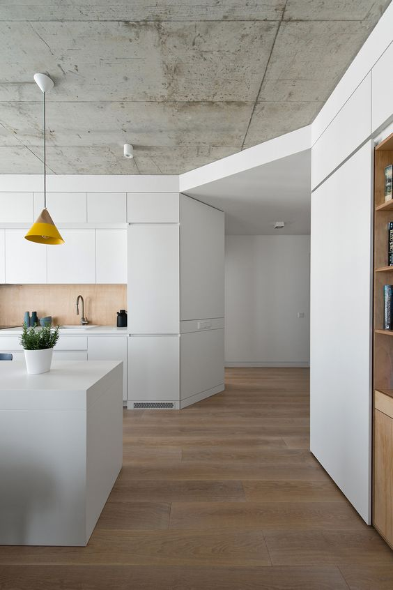 modern all-white space with a concrete ceiling
