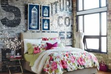 bedroom with a brick wall