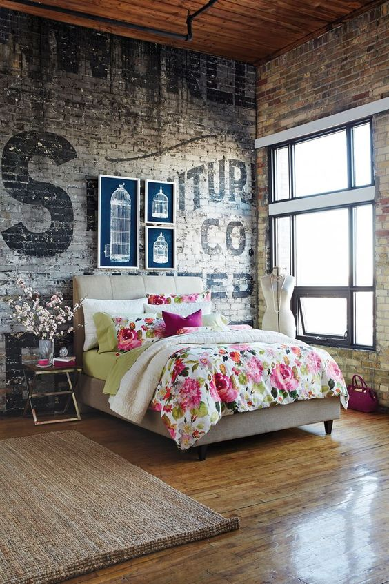 vintage industrial brick walls and contrasting decor for a bedroom
