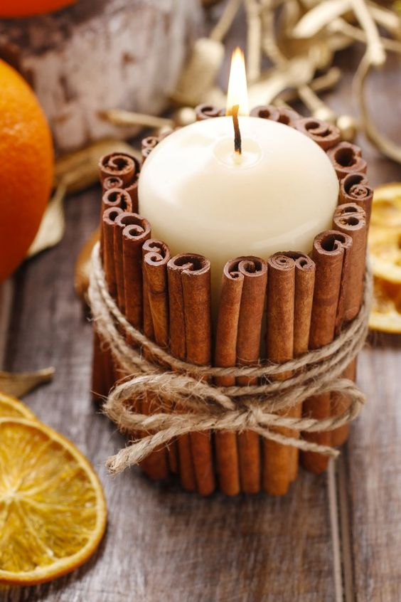 37 candle decorated with cinnamon sticks