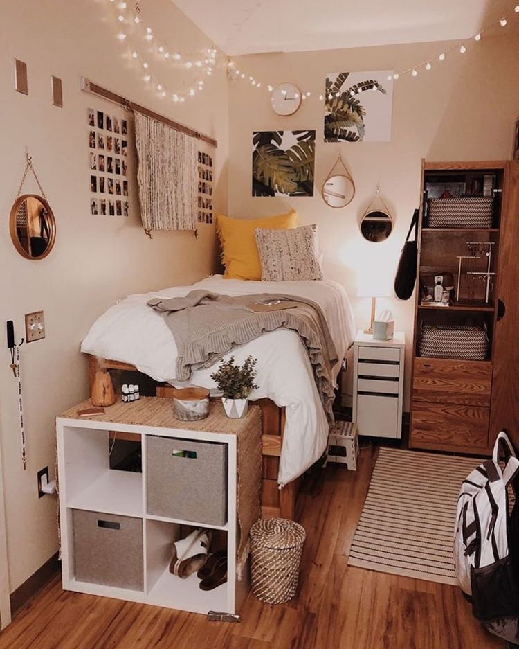 ikea kallax is a practical storage solution for a dorm room that can act as a room divider (via undefined)
