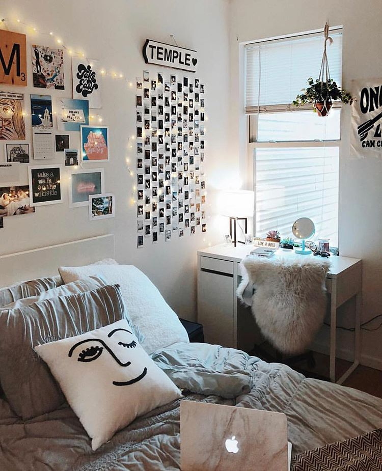 an insta photo wall is a trendy addition to any room's decor (via @vscodorms)