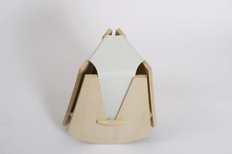 The Geometric Stool is a unique piece made of light colored wood and leather with a creative modern design