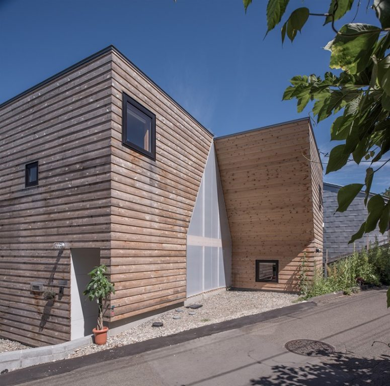 This Japanese residence has a creative facade with a house cutout right in it