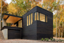 01 This forest cabin in blackened wood was built for a car-lover owner