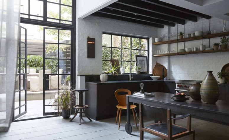 This Moody Kitchen Decorted In Industrial Meets Vintage Style Features A Classic Black And White Color