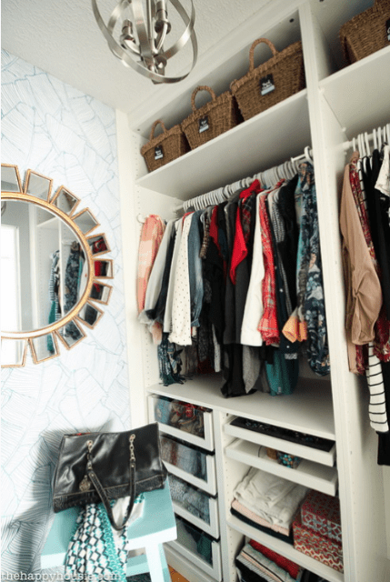 The closet was organized with the help of IKEA Pax system, which is very comfortable for any kind of storage