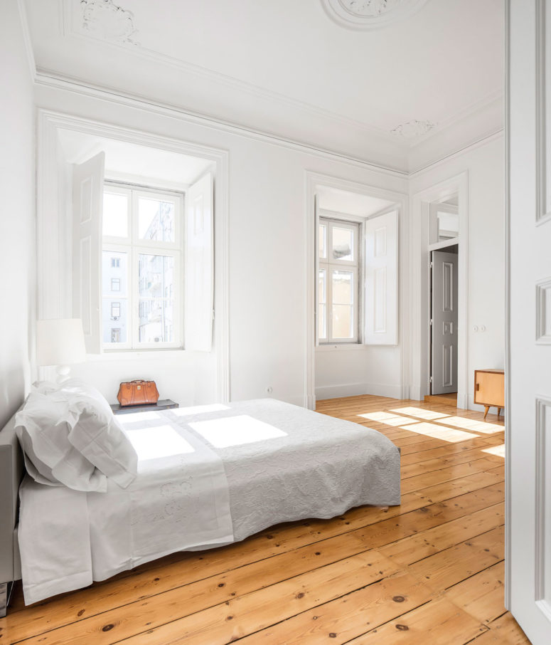 The original molding and wooden floors were restored to preserve that chic and unique personality of the space