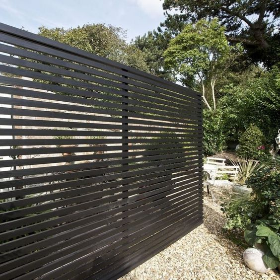 a black wooden fence can make a stylish statement in your backyard - Fence Design Ideas