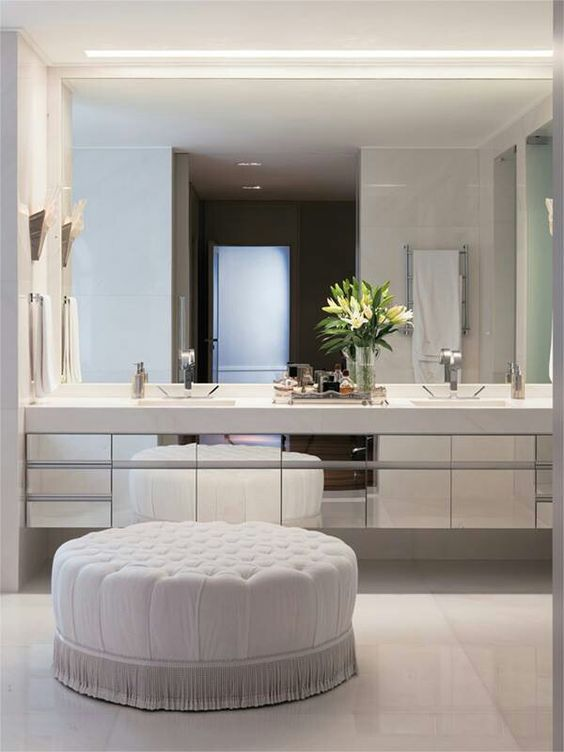 A Mirror Wall, Mirrored Cabinets And White Statuary Marble On The Wall And  On The