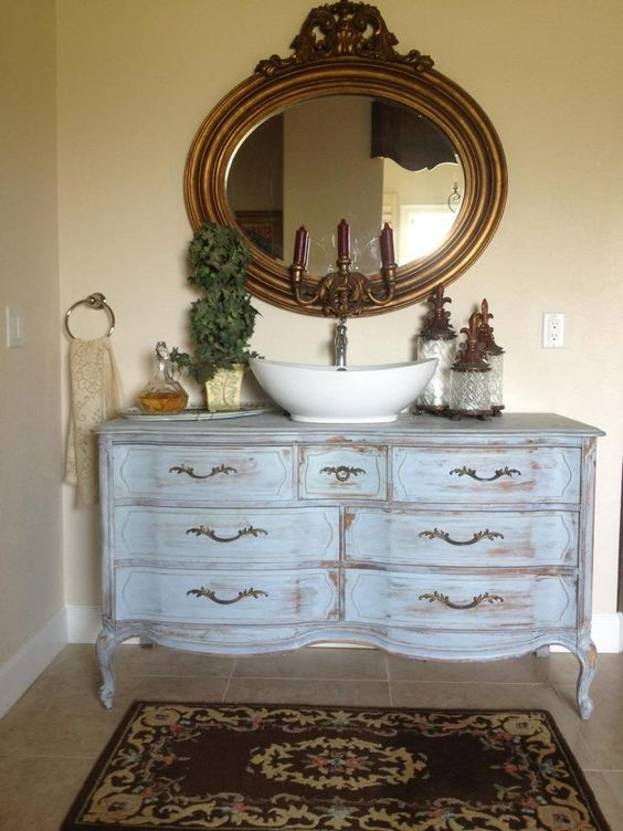An Old Dresser Was Whitewashed And Repurposed Into A Bathroom Cabinet
