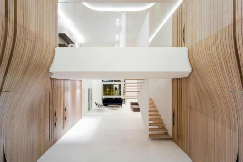 Uneven walls bring a different kind of dynamic to the living space, while wood brings comfort and warmth