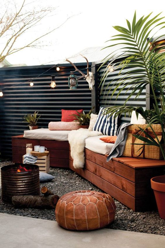 black corrugated metal fence for a boho chic backyard - Fence Design Ideas