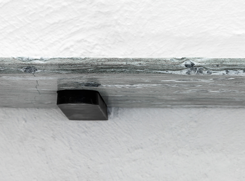 A cool grey stone slab takes on a 7.5° taper as it extends outwards from the wall