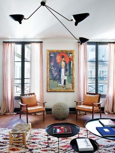 The apartment is filled with light and an open layout helps with that, bold artworks and textiles make it chic and eye-catchy