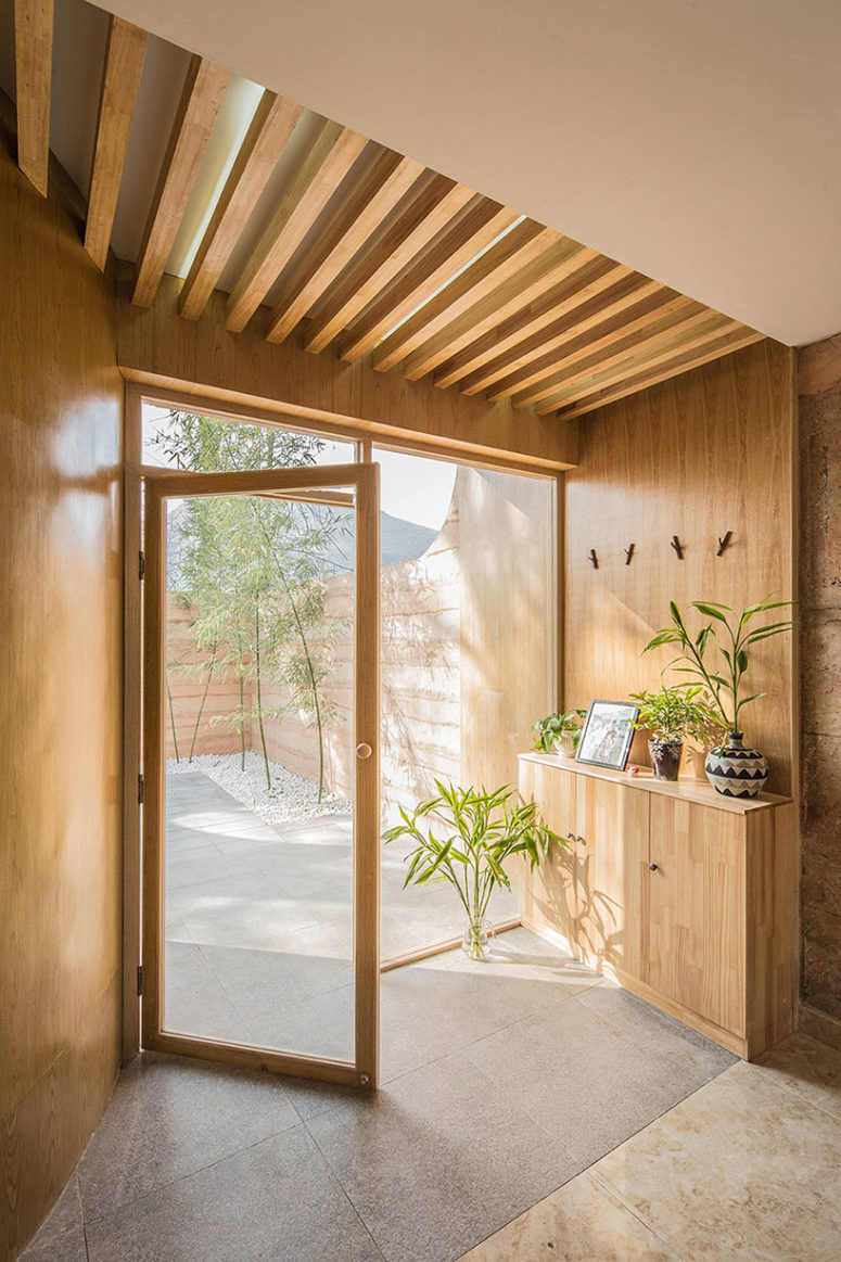 The interiors are covered with light-colored wood and tiles to connect them to outdoors and make them cozy and inviting
