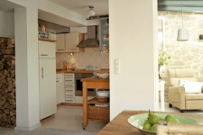 04 The kitchen is a small nook decorated in the same creamy shades and though it's small, there's everything necessary