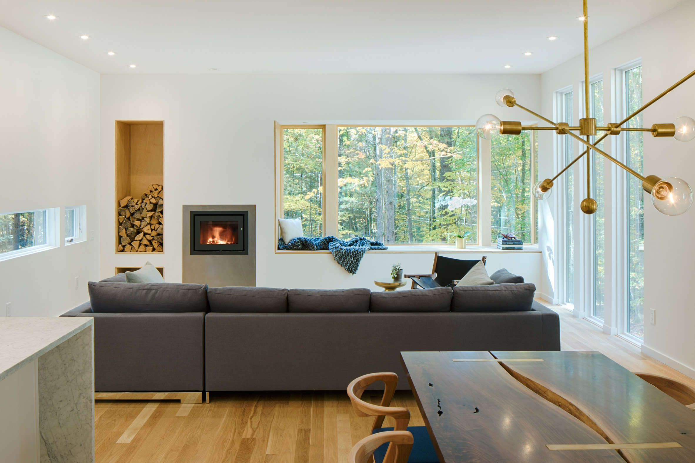 living room with a stylish firewood storage in a wall